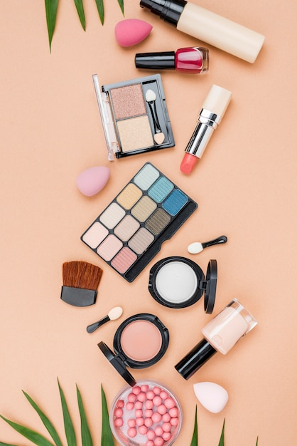 Top view set of beauty products on beige background Premium Photo