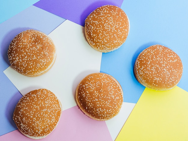 Top view set of tasty buns on colorful background Free Photo