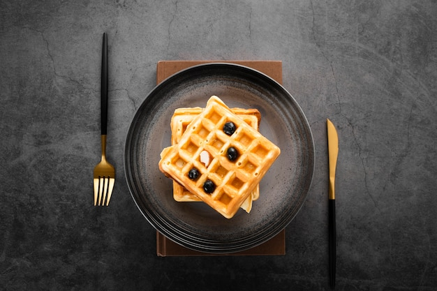 Top view set of two waffles with gold cutlery Free Photo
