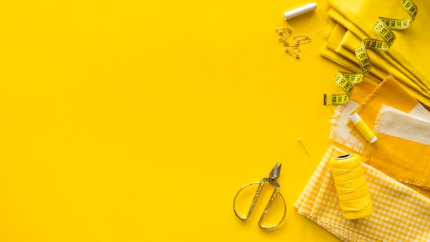 Top view of sewing essentials with copy space Free Photo