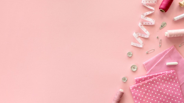 Top view of sewing essentials with measuring tape Free Photo