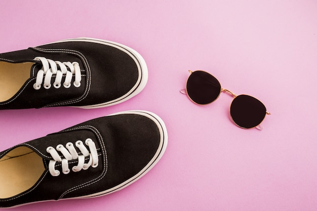 Top view shoes and sunglasses Free Photo