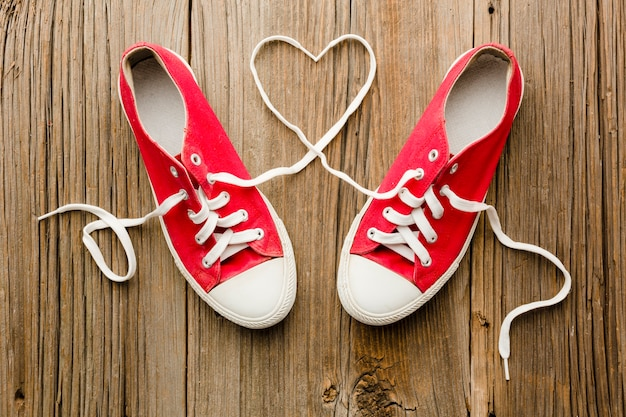 Top view of shoes for valentines day with heart shape Free Photo