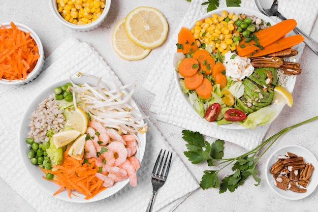 Top view of shrimp and vegetables on plates Free Photo