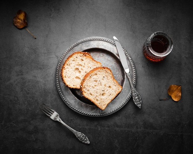 Top view silver cutlery set up with bread and tea Free Photo