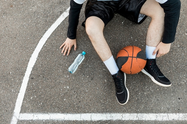 Top view sitting man with basketball Free Photo