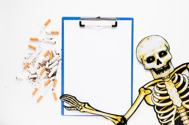 Top view skeleton with cigarettes Free Photo