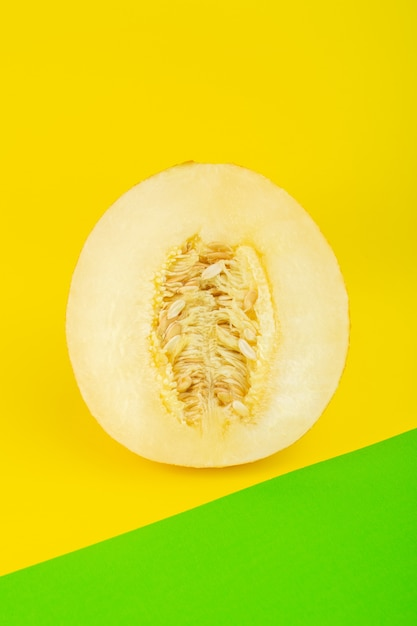 A top view sliced fresh melon sweet pulpy mellow isolated on green-yellow Free Photo