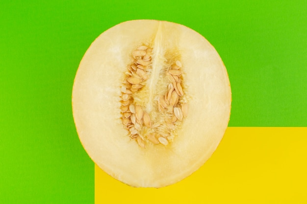 A top view sliced fresh melon sweet pulpy mellow isolated on green Free Photo