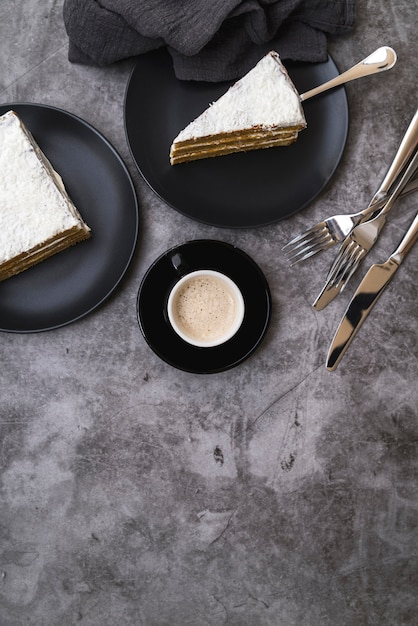 Top view slices of cake with coffee on the table Free Photo