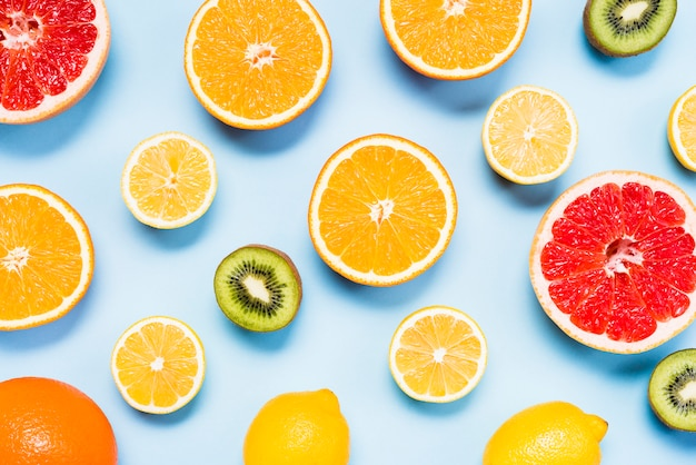 Top view of slices of citrus fruits, kiwis Free Photo