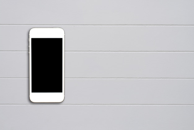 Top view smartphone mock up template with black screen on cement table with copyspace. Free Photo