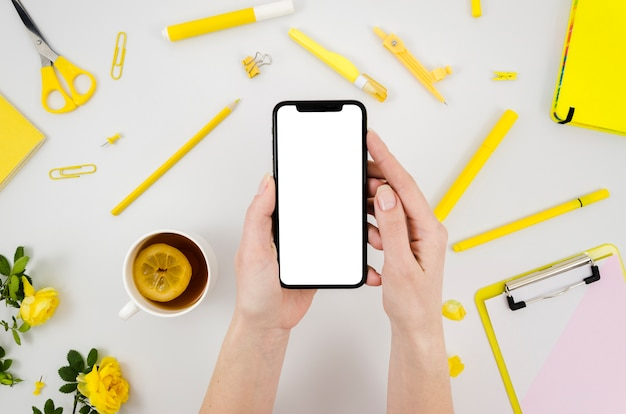 Top view smartphone template over workspace Premium Photo
