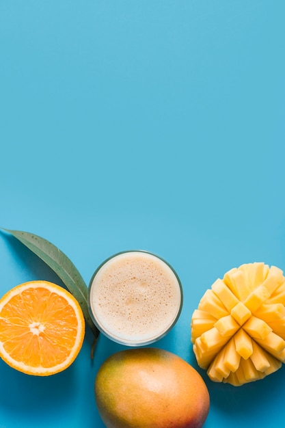 Top view smoothie with mango and orange with copy-space Premium Photo