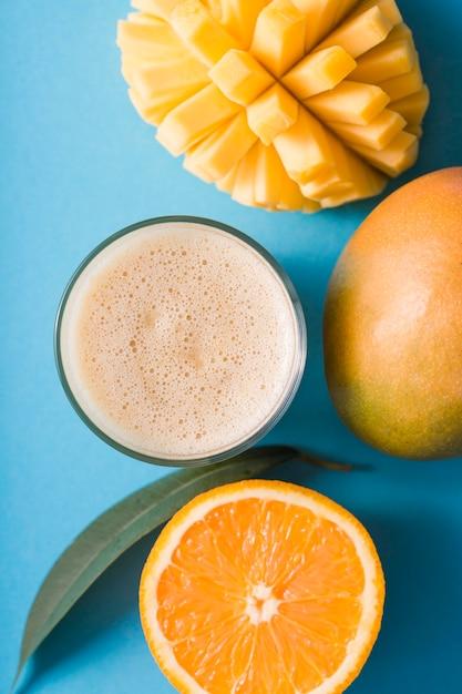 Top view smoothie with mango and orange Free Photo