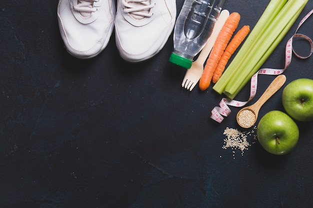 Top view of sneakers with vegetables and apples Free Photo