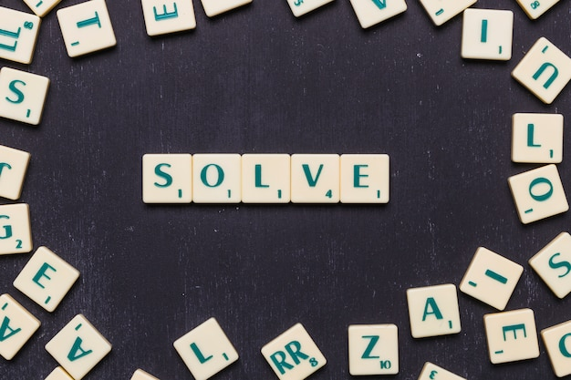 Top view of solve text made from scrabble game letters Free Photo