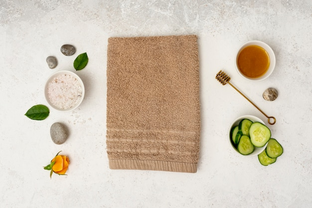 Top view spa concept with towel and honey Free Photo