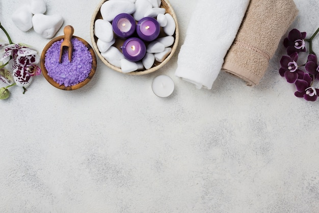 Top view spa towels and candles with copy space Free Photo