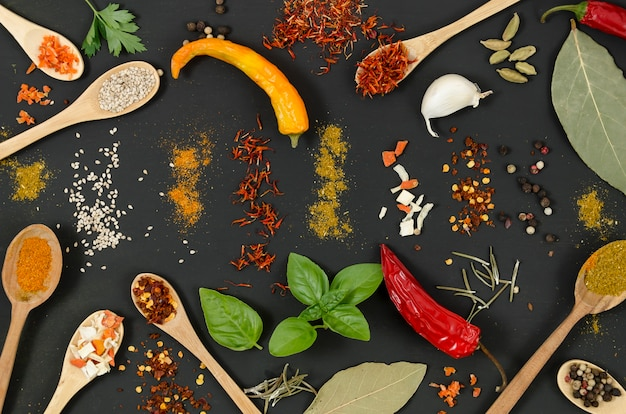 Top view spices and chillies on black background Free Photo