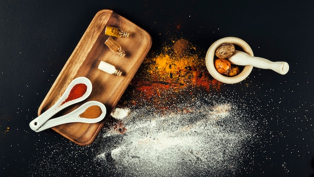 Top view of spices on wooden board Free Photo