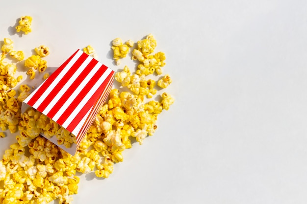 Top view spilled popcorn box Free Photo