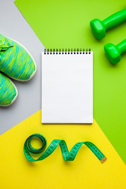 Top view sports equipment and notebook mock-up Free Photo