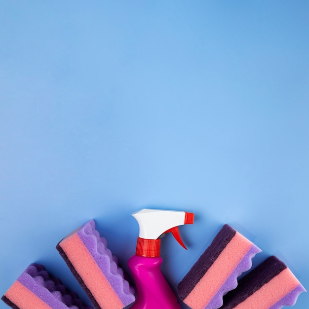 Top view spray bottle and sponges Free Photo
