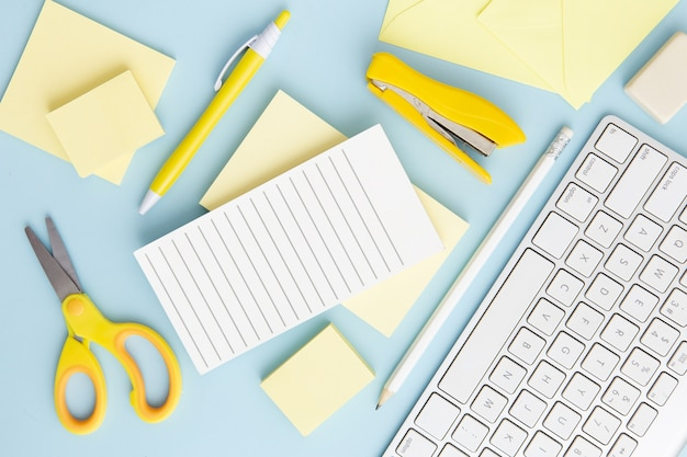Top view stationary arrangement on blue background Free Photo