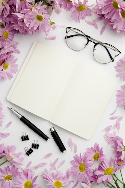 Top view stationary arrangement on desk with notebook and glasses Free Photo