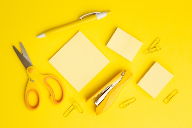 Top view stationary arrangement on yellow background Free Photo