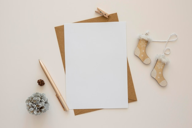 Top view stationery empty papers with winter decor Free Photo