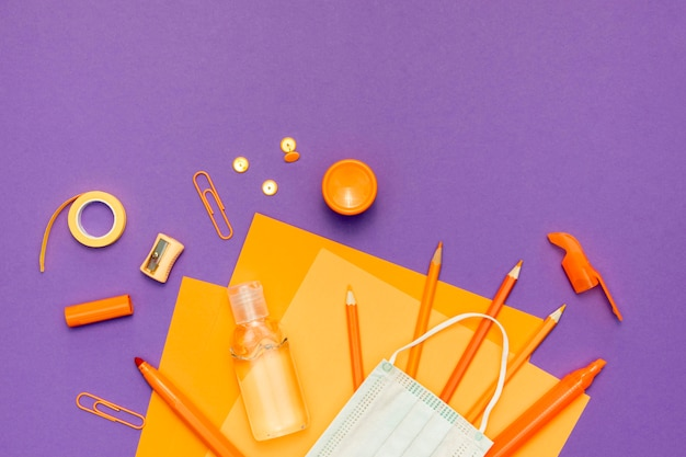 Top view supplies on purple background Free Photo