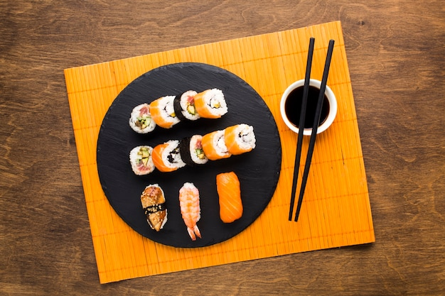 Top view sushi plating on bamboo mat Free Photo