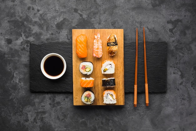 Top view sushi plating on slate background Premium Photo