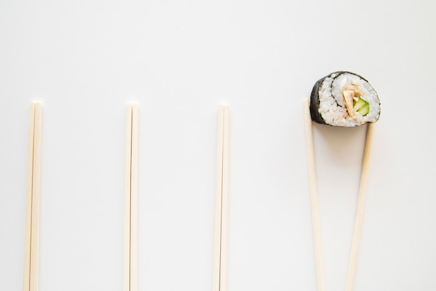 Top view sushi roll with chopsticks Free Photo