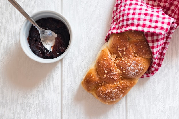 Top view of sweet bread and jam on wooden table Free Photo