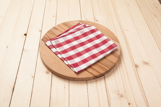 Top view of table cloth, kitchen napkin on wooden table Premium Photo