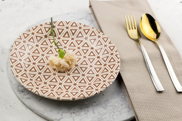 Top view table setting with fresh flower Premium Photo