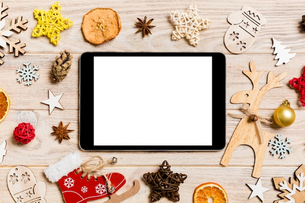Top view of tablet on holiday wooden background Premium Photo
