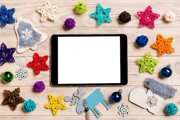 Top view of tablet on holiday wooden. Premium Photo