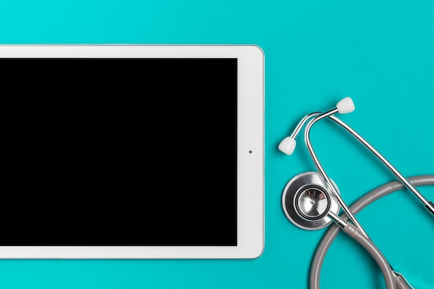 Top view tablet with medical stethoscope Free Photo
