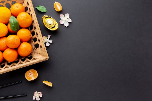 Top view of tangerine basket chinese new year Free Photo