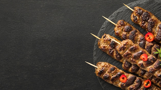Top view of tasty kebab on plate with copy space Free Photo