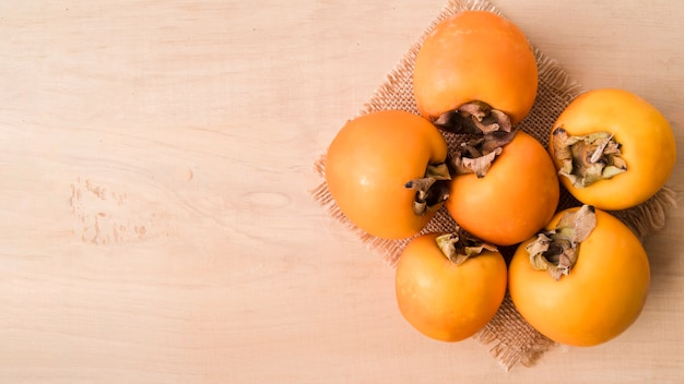 Top view tasty persimmons with copy space Free Photo