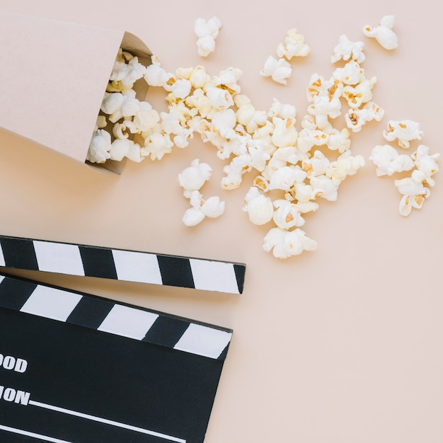 Top view tasty popcorn with movie clapperboard Free Photo