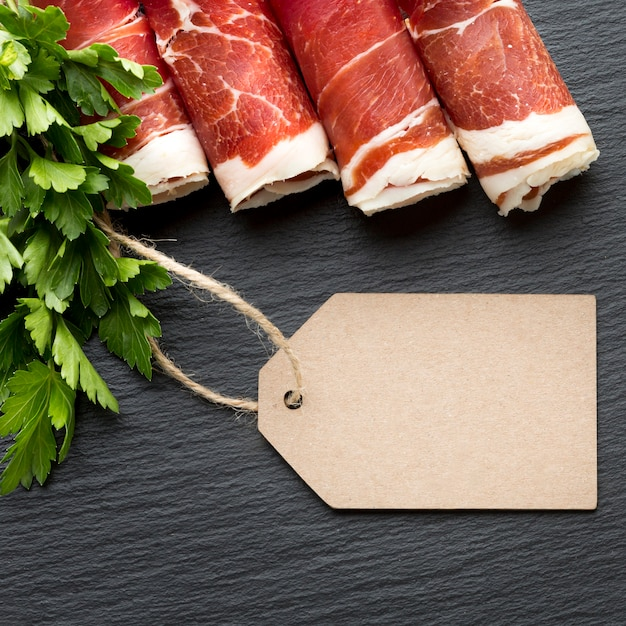 Top view tasty selection of pork meat with parsley Free Photo