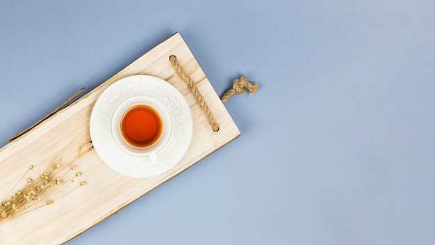 Top view tea cup on wooden tray Free Photo