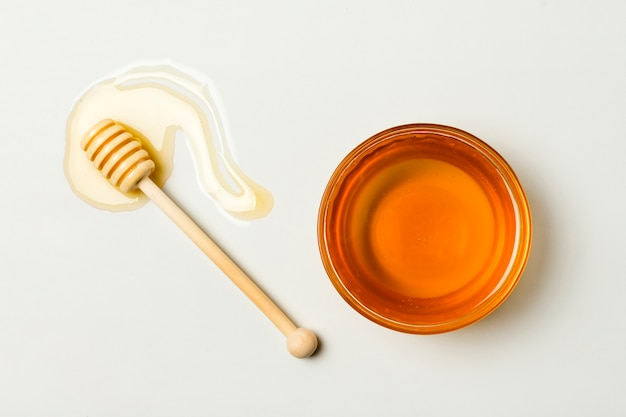 Top view tea with spoon and honey stain Free Photo