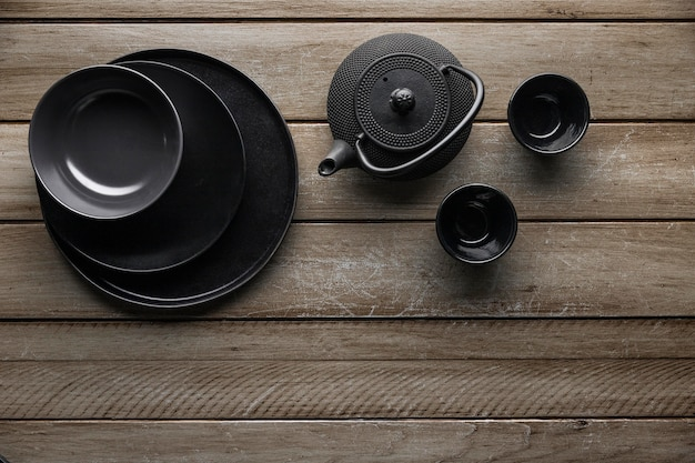 Top view of teapot with dishware Free Photo